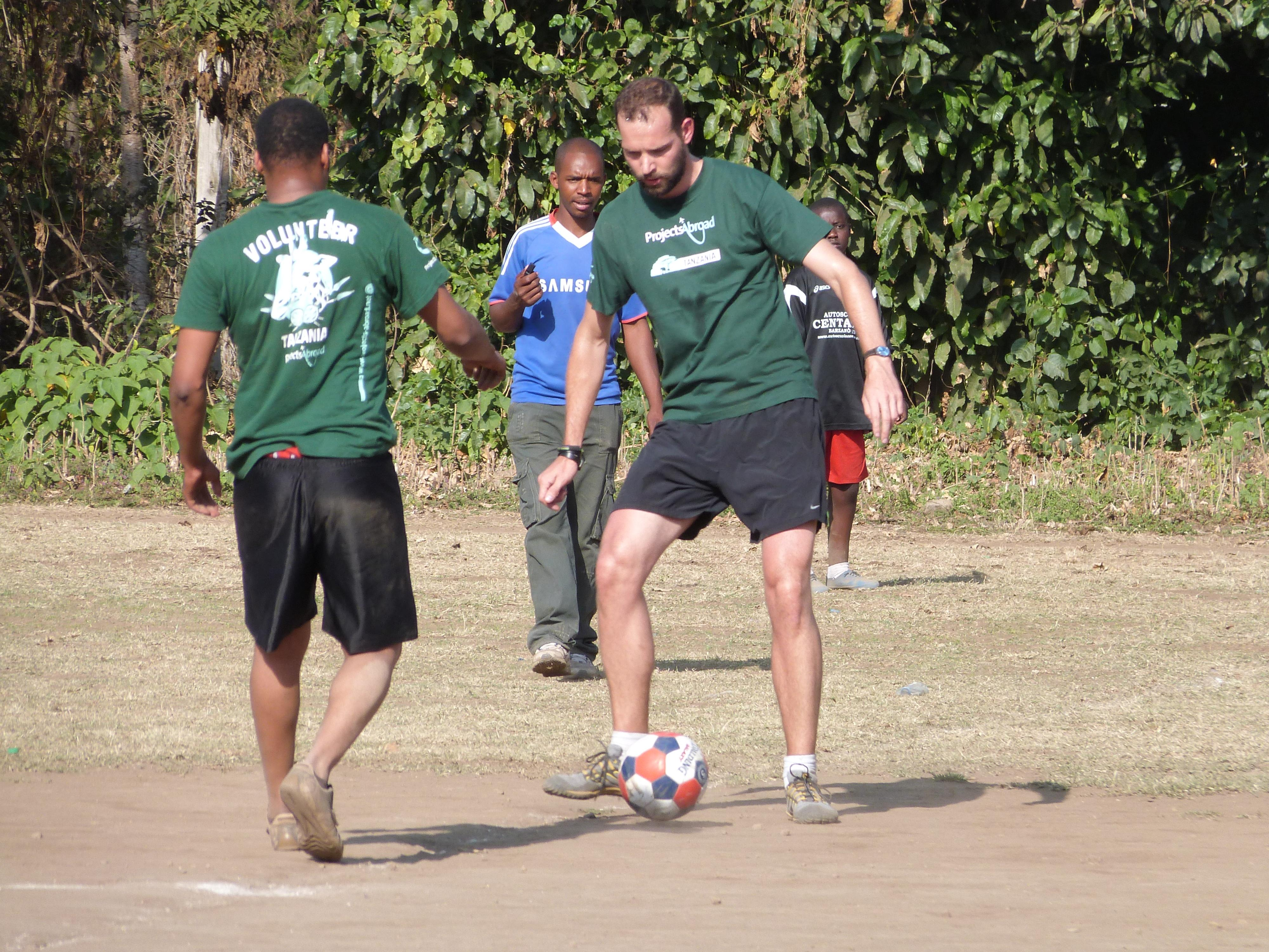 Volunteers practise their passing in preparation to coach sports in schools in Tanzania